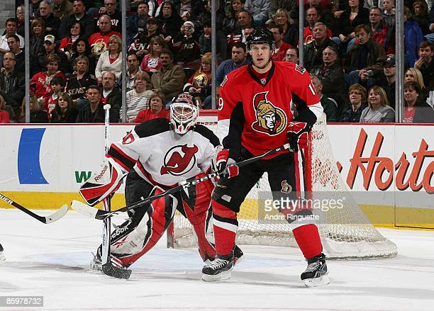 Jason Spezza of the Ottawa Senators skates against Martin Brodeur of the New Jersey Devils at Scotiabank Place on April 9 2009 in Ottawa Ontario...