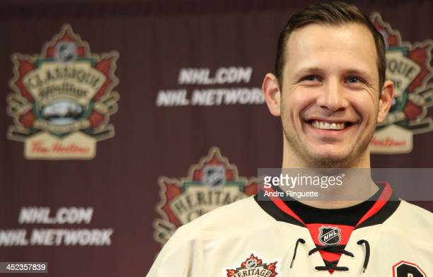 Jason Spezza of the Ottawa Senators smiles as he answers questions from the media during the unveiling of the NHL Heritage Classic jerseys at...