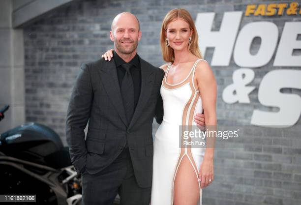 Jason Statham and Rosie HuntingtonWhiteley attend the premiere of Universal Pictures' Fast Furious Presents Hobbs Shaw at Dolby Theatre on July 13...
