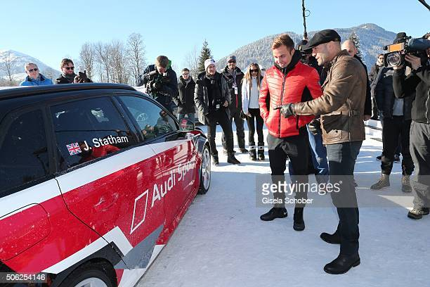 Jason Statham and soccer player Mario Goetze attend the Audi driving experience during the Audi Hahnenkamm race weekend on January 22 2016 in...