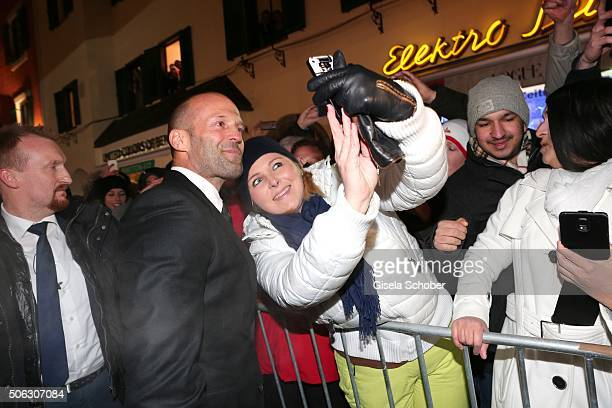 Jason Statham doing a selfie with fans during the AUDI Night 2016 during Hahnenkamm Race Weekend on January 22 2016 in Kitzbuehel Austria