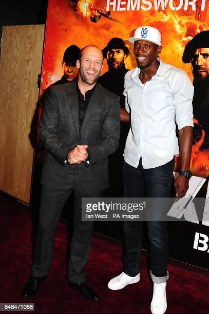 000d67bef47 Jason Statham with Olympic Gold Medalist Usain Bolt arriving for the UK  Premiere of The Expendables