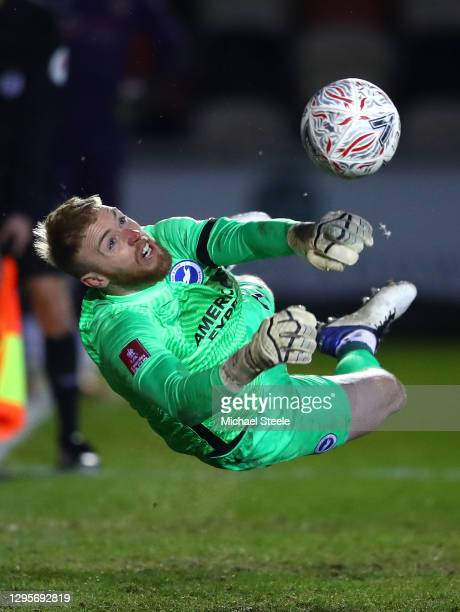 Jason Steele of Brighton and Hove Albion saves a penalty from Scot Bennett of Newport County in the shootout during the FA Cup Third Round match...