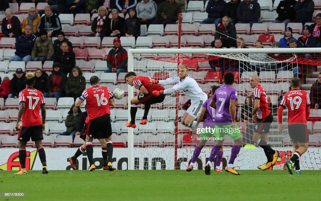 Jason Steele of Sunderland (C) makes a save during the Sky Bet Championship match between Sunderland and Bristol City at Stadium of Light on October 28, 2017 in Sunderland, England.