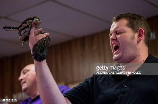 Jason Stone holds a timber rattlesnake during a Pentecostal serpent handlers service at the House of the Lord Jesus church in Squire West Virginia on...