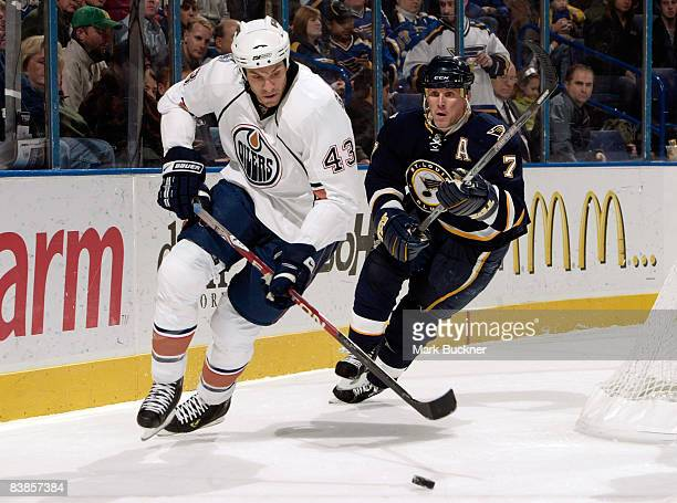 Jason Strudwick of the Edmonton Oilers handles the puck while Keith Tkachuk of the St Louis Blues gives chase on November 29 2008 at Scottrade Center...