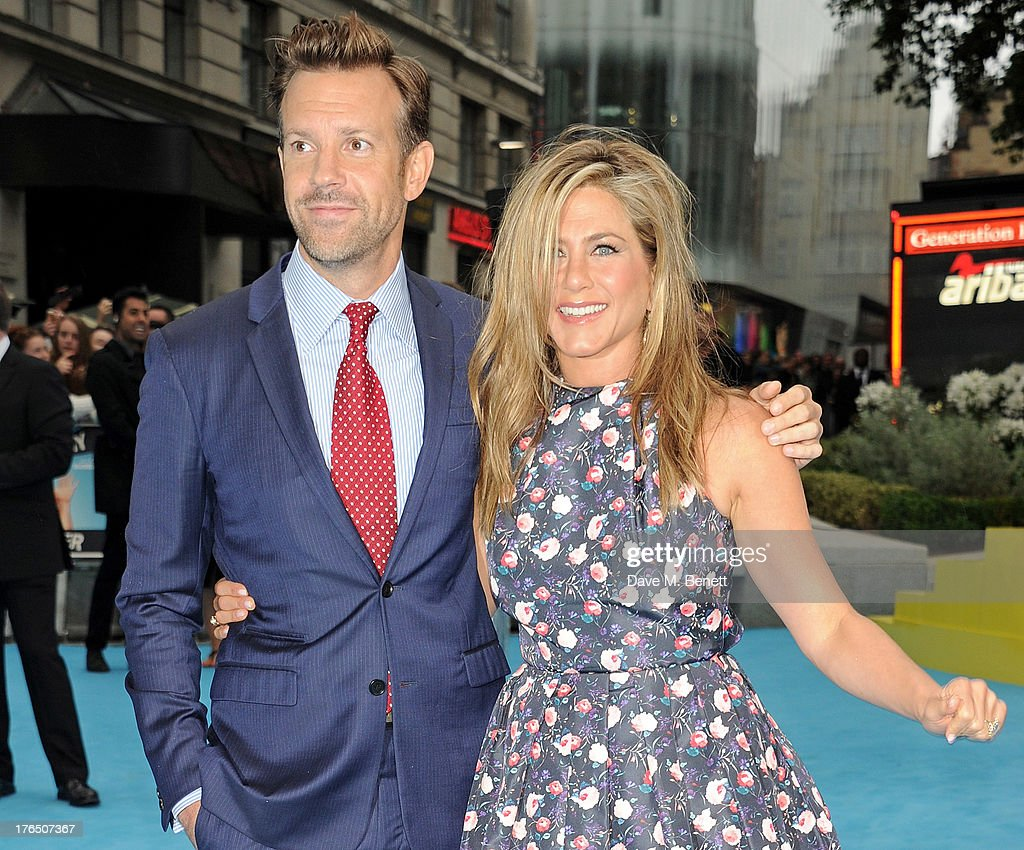 Jason Sudeikis (L) and Jennifer Aniston attend the European Premiere of 'We're The Millers' at Odeon West End on August 14, 2013 in London, England.
