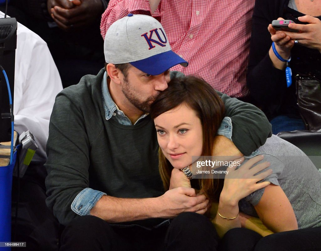 Jason Sudeikis and Olivia Wilde attend the Toronto Raptors vs New York Knicks game at Madison Square Garden on March 23, 2013 in New York City.