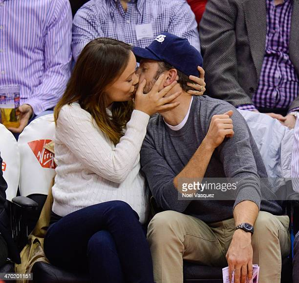 Jason Sudeikis and Olivia Wilde kiss at a basketball game between the San Antonio Spurs and the Los Angeles Clippers at Staples Center on February 18...