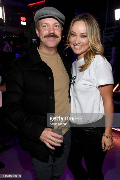 Jason Sudeikis and Olivia Wilde pose backstage at iHeartRadio's Z100 Jingle Ball 2019 Presented By Capital One on December 13, 2019 in New York City.