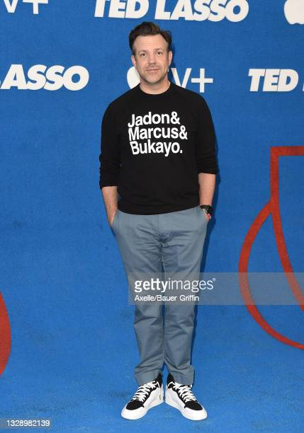 """Jason Sudeikis wears a top featuring the names of England football players Jadon Sancho, Marcus Rashford and Bukayo Saka as he attends Apple's """"Ted..."""