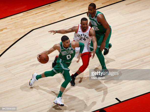 Jason Tatum of the Boston Celtics handles the ball against the Toronto Raptors on April 4 2018 at the Air Canada Centre in Toronto Ontario Canada...