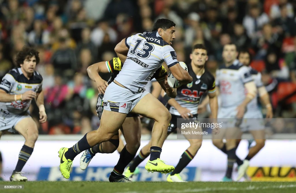 Jason Taumalolo of the Cowboys breaks through tackles during the round 23 NRL match between the Penrith Panthers and the North Queensland Cowboys at Pepper Stadium on August 12, 2017 in Sydney, Australia.