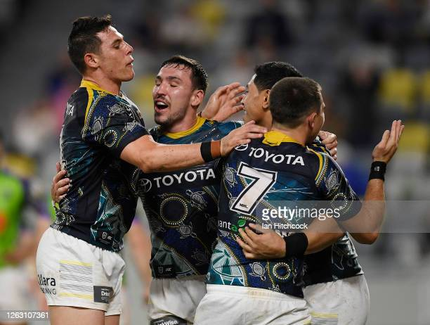 Jason Taumalolo of the Cowboys celebrates after scoring a try during the round 12 NRL match between the North Queensland Cowboys and the Canberra...