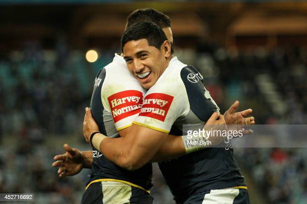 Jason Taumalolo of the Cowboys celebrates with try-scorer Antonio Winterstein during the round 20 NRL match between the Canterbury Bulldogs and the...