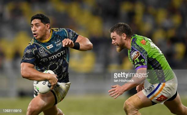 Jason Taumalolo of the Cowboys gets past Elliott Whitehead of the Raiders during the round 12 NRL match between the North Queensland Cowboys and the...