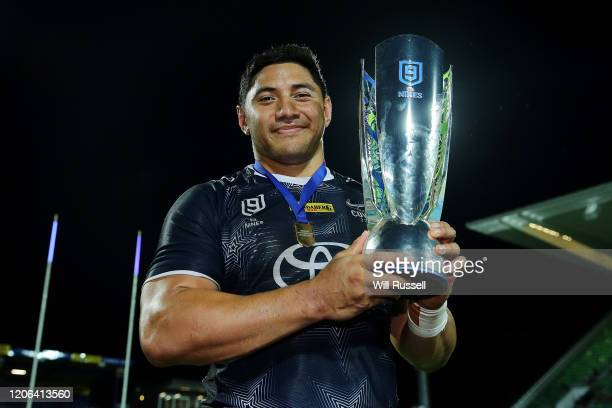 Jason Taumalolo of the Cowboys holds under pressure from the trophy after winning the Final against the Dragons during Day 2 of the 2020 NRL Nines at...