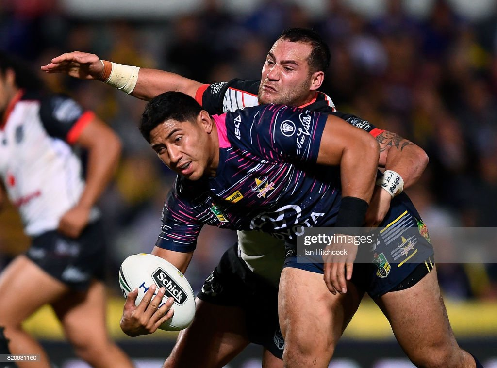 Jason Taumalolo of the Cowboys is tackled by Bodene Thompson of the Warriors during the round 20 NRL match between the North Queensland Cowboys and the New Zealand Warriors at 1300SMILES Stadium on July 22, 2017 in Townsville, Australia.