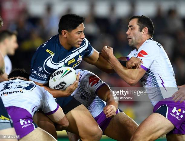 Jason Taumalolo of the Cowboys is tackled by Cameron Smith of the Storm during the round 12 NRL match between the North Queensland Cowboys and the...