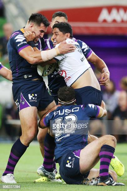 Jason Taumalolo of the Cowboys is tackled by Dean Finucane of the Storm during the round three NRL match between the Melbourne Storm and the North...