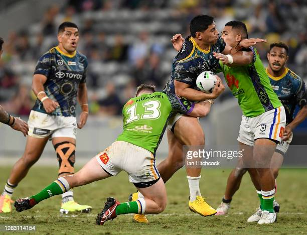 Jason Taumalolo of the Cowboys is tackled by Hudson Young of the Raiders during the round 12 NRL match between the North Queensland Cowboys and the...