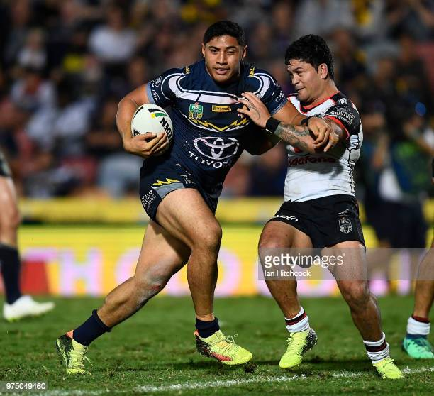 Jason Taumalolo of the Cowboys is tackled by Issac Luke of the Warriors during the round 15 NRL match between the North Queensland Cowboys and the...