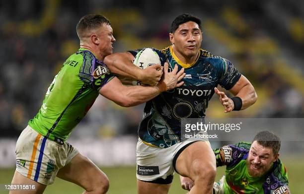 Jason Taumalolo of the Cowboys is tackled by Jack Wighton of the Raiders during the round 12 NRL match between the North Queensland Cowboys and the...