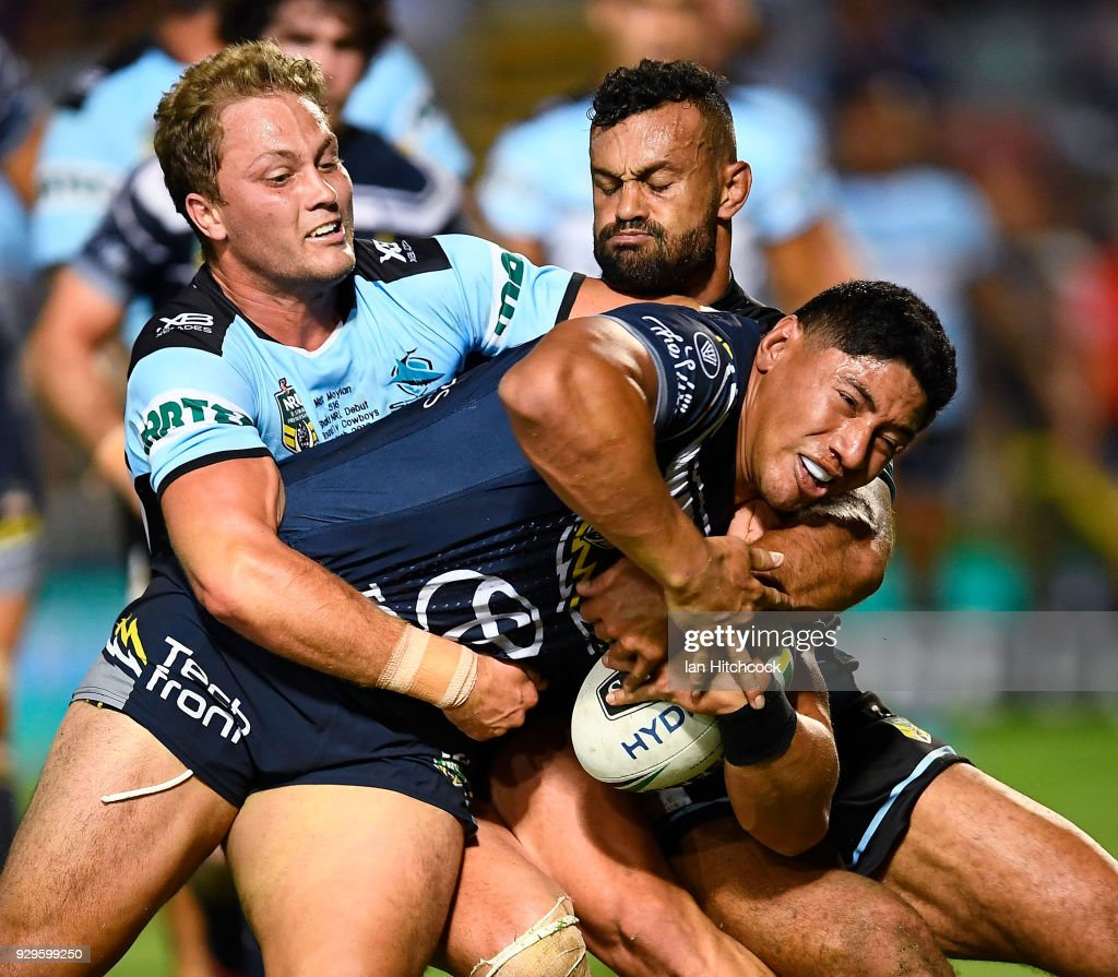 Jason Taumalolo of the Cowboys is tackled by Matt Moylan of the Sharks during the round one NRL match between the North Queensland Cowboys and the Cronulla Sharks at 1300SMILES Stadium on March 9, 2018 in Townsville, Australia.