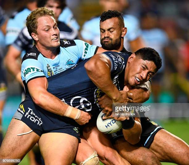 Jason Taumalolo of the Cowboys is tackled by Matt Moylan of the Sharks during the round one NRL match between the North Queensland Cowboys and the...