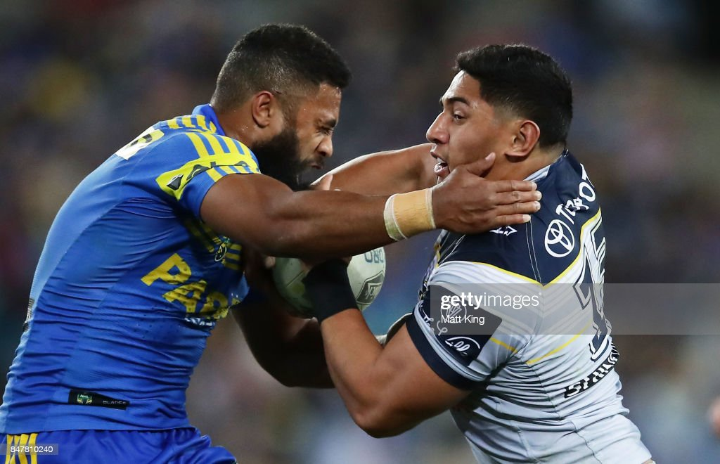 Jason Taumalolo of the Cowboys is tackled by Michael Jennings of the Eels during the NRL Semi Final match between the Parramatta Eels and the North Queensland Cowboys at ANZ Stadium on September 16, 2017 in Sydney, Australia.