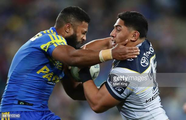 Jason Taumalolo of the Cowboys is tackled by Michael Jennings of the Eels during the NRL Semi Final match between the Parramatta Eels and the North...