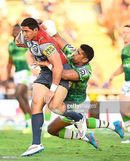 Jason Taumalolo of the Cowboys is tackled by Sia Soliola of the Raiders during the round 21 NRL match between the North Queensland Cowboys and the...