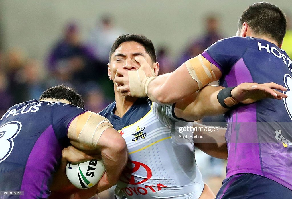 Jason Taumalolo of the Cowboys is tackled during the NRL Qualifying Final match between the Melbourne Storm and the North Queensland Cowboys at AAMI Park on September 10, 2016 in Melbourne, Australia.