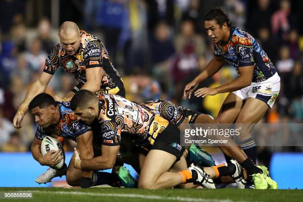 Jason Taumalolo of the Cowboys is tackled during the round 10 NRL match between the Wests Tigers and the North Queensland Cowboys at Leichhardt Oval...