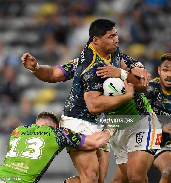 Jason Taumalolo of the Cowboys is tackled during the round 12 NRL match between the North Queensland Cowboys and the Canberra Raiders at QCB Stadium...