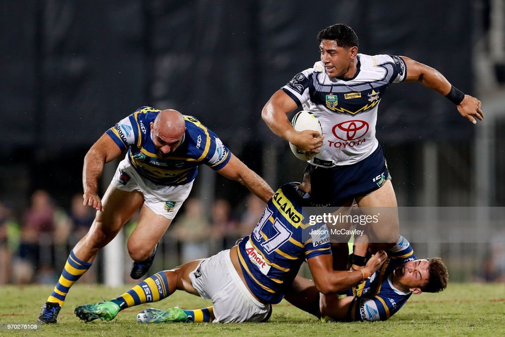 Jason Taumalolo of the Cowboys is tackled during the round 14 NRL match between the Parramatta Eels and the North Queensland Cowboys at TIO Stadium on June 9, 2018 in Darwin, Australia.