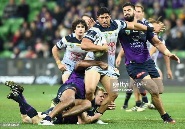 Jason Taumalolo of the Cowboys is tackled during the round 15 NRL match between the Melbourne Storm and the North Queensland Cowbpys at AAMI Park on...