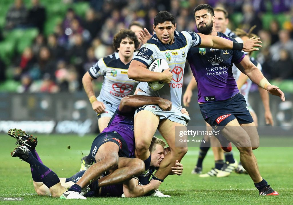 Jason Taumalolo of the Cowboys is tackled during the round 15 NRL match between the Melbourne Storm and the North Queensland Cowbpys at AAMI Park on June 17, 2017 in Melbourne, Australia.