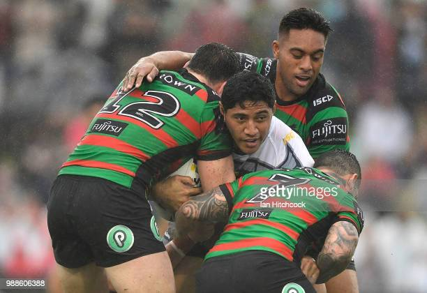Jason Taumalolo of the Cowboys is wrapped up by the Rabbitohs defence during the round 16 NRL match between the South Sydney Rabbitohs and the North...