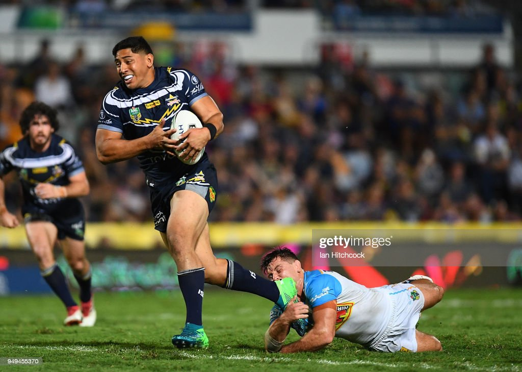 Jason Taumalolo of the Cowboys makes a break on his way to score a try during the round seven NRL match between the North Queensland Cowboys and the Gold Coast Titans at 1300SMILES Stadium on April 21, 2018 in Townsville, Australia.