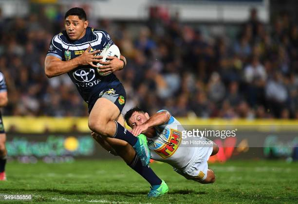 Jason Taumalolo of the Cowboys makes a break on his way to score a try during the round seven NRL match between the North Queensland Cowboys and the...