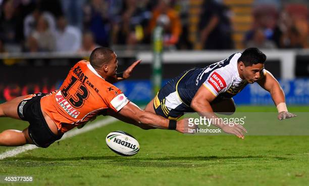 Jason Taumalolo of the Cowboys scores a try during the round 22 NRL match between the North Queensland Cowboys and the Wests Tigers at 1300SMILES...