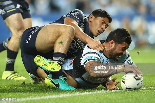 Jason Taumalolo of the Cowboys tackles Andrew Fifita of the Sharks as he scores a try only to have it disallowed for a double movement during the NRL...