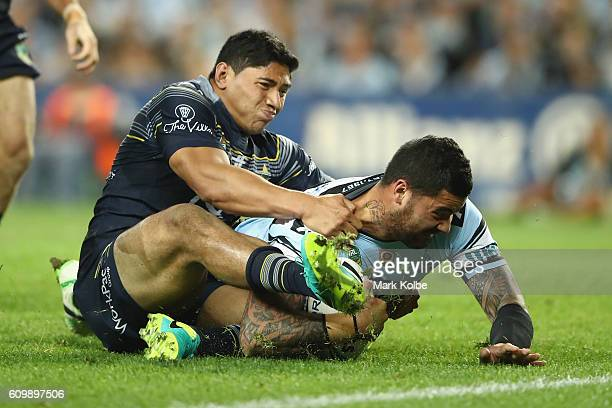 Jason Taumalolo of the Cowboys tackles Andrew Fifita of the Sharks as he atempts to score a try during the NRL Preliminary Final match between the...