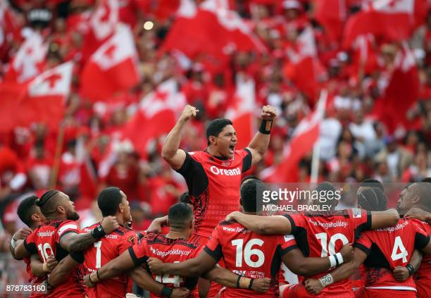 Jason Taumalolo of Tonga and teammates lay down the challenge prior to the Rugby League World Cup men's semifinal match between Tonga and England at...