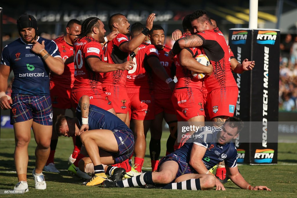 Jason Taumalolo of Tonga celebrates a try with team mates during the 2017 Rugby League World Cup match between Scotland and Tonga at Barlow Park on October 29, 2017 in Cairns, Australia.