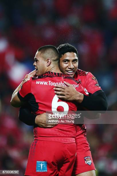 Jason Taumalolo of Tonga celebrates with teammate Tuimoala Lolohea after winning the 2017 Rugby League World Cup match between Samoa and Tonga at...