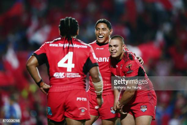 Jason Taumalolo of Tonga celebrates with teammates Tuimoala Lolohea and Solomone Kata after winning the 2017 Rugby League World Cup match between...