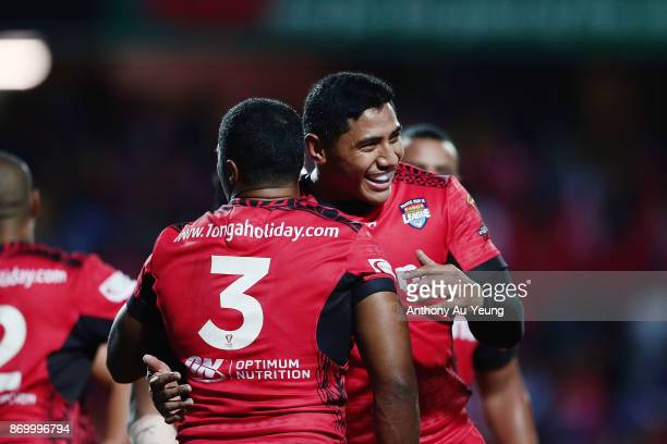 Jason Taumalolo of Tonga congratulates teammate Michael Jennings on his try during the 2017 Rugby League World Cup match between Samoa and Tonga at...