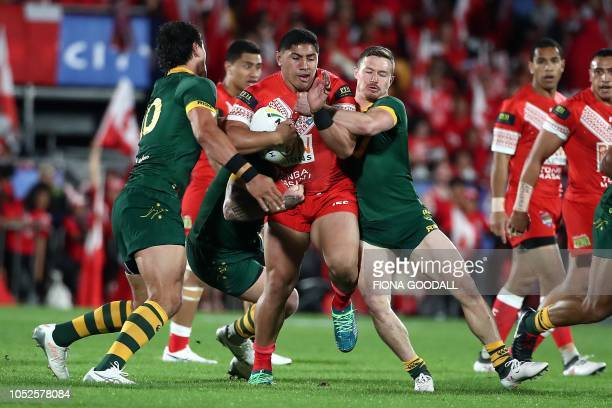 Jason Taumalolo of Tonga is tackled by Australian players during the rugby league international Test match between Australia and Tonga at Mt Smart...